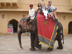 Family on elephant at Amber Fort 4